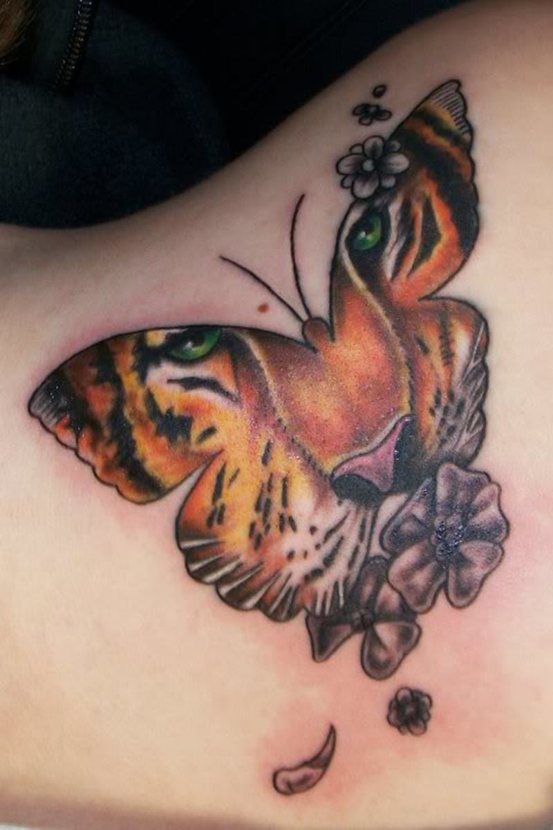 This is very similar to my tattoo, but on mine the face looks more like butterfly markings.