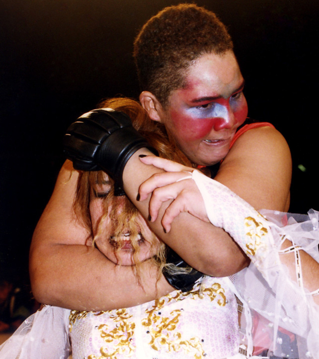 Aja Kong with a sleeper hold