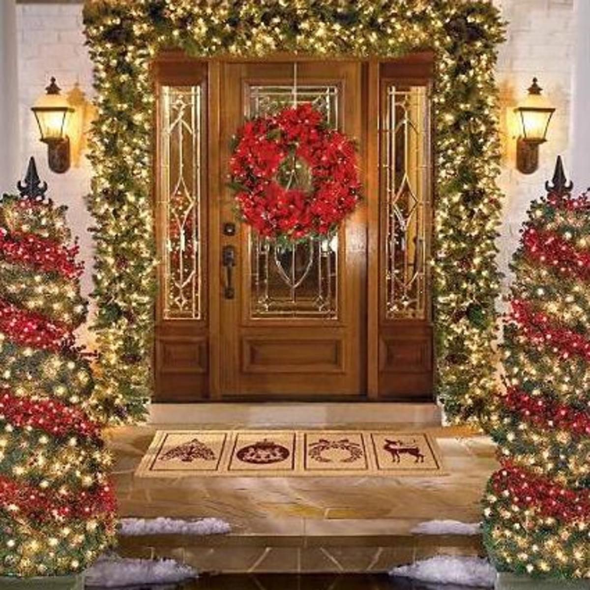 Garland christmas lights hubpages wreath with christmas lights on entry door mozeypictures Images
