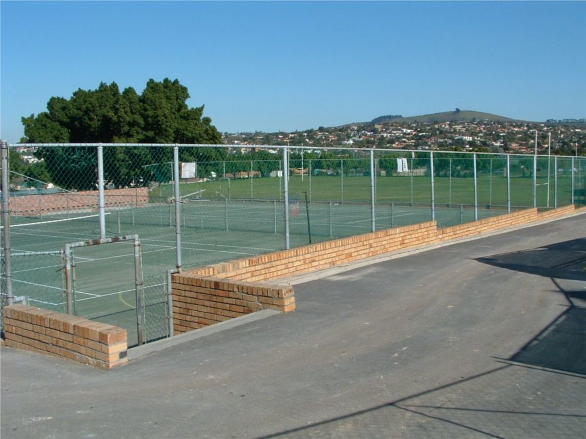 Two of the four tennis courts, laid by Barretts in 1977.