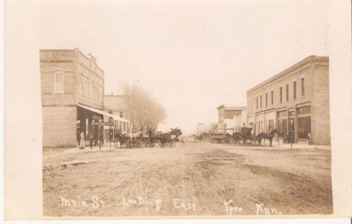 His description of the scene: Downtown Main Street looking east. The IOOF bldg is n left forefront and the hotel is east of it. The Deuel store is in right forefront.