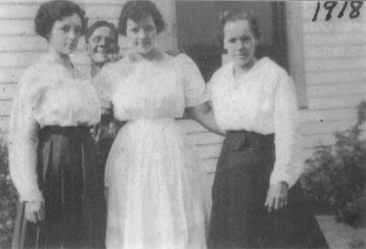 My grandmother (Ruth) in the center. Her friend, Bertha McGhee on the right. Ruth married Bertha's brother.