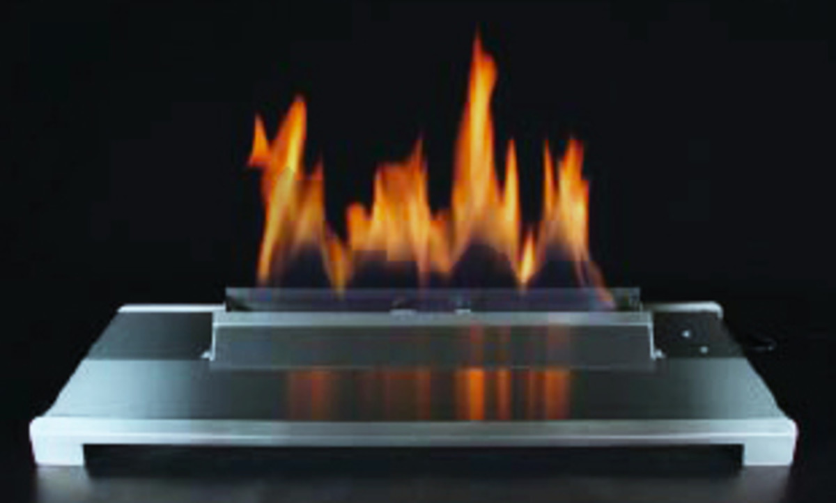 stainless steel ventless gas log burner alone in fireplace
