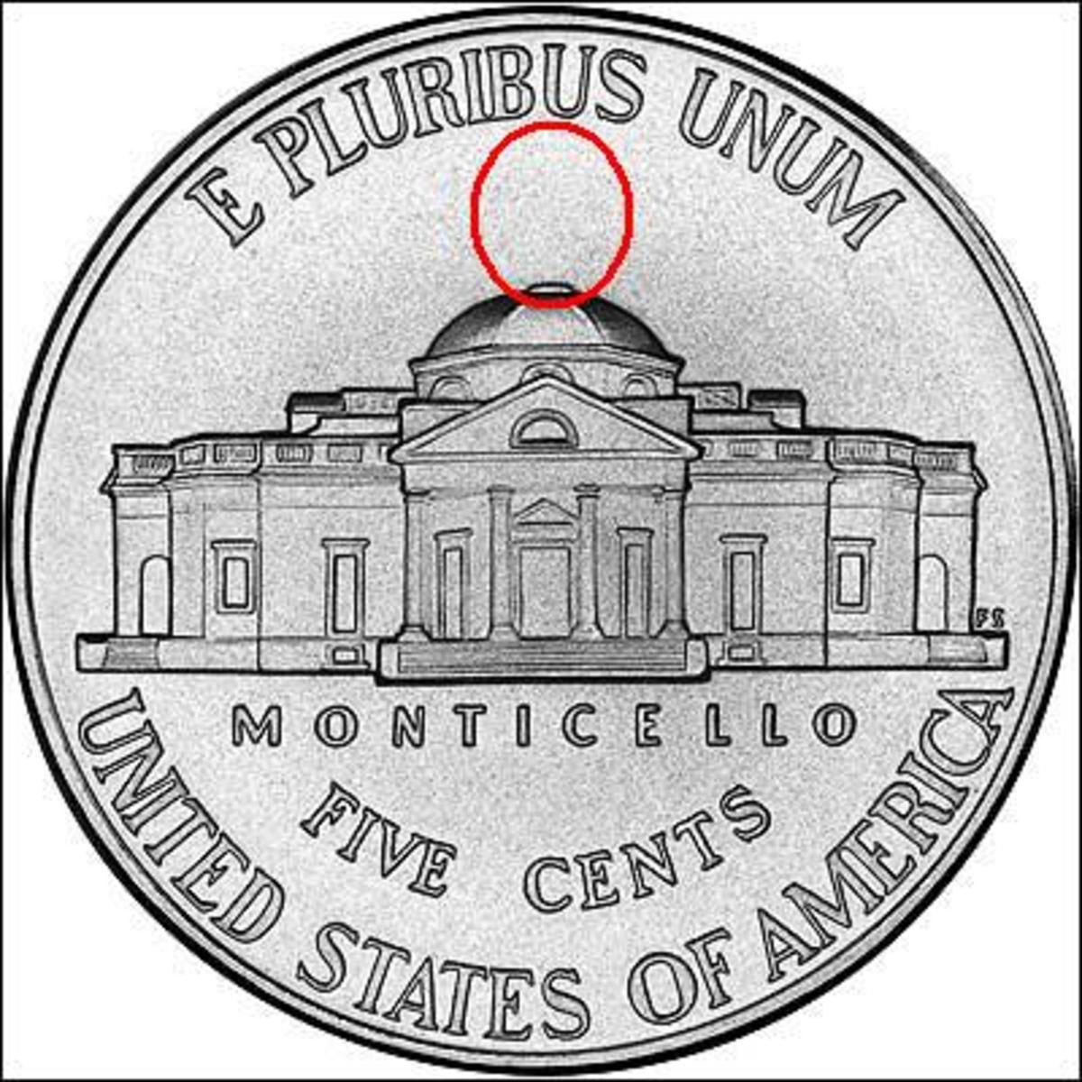 A non-Silver Nickel will lack the mint mark above Monticello.