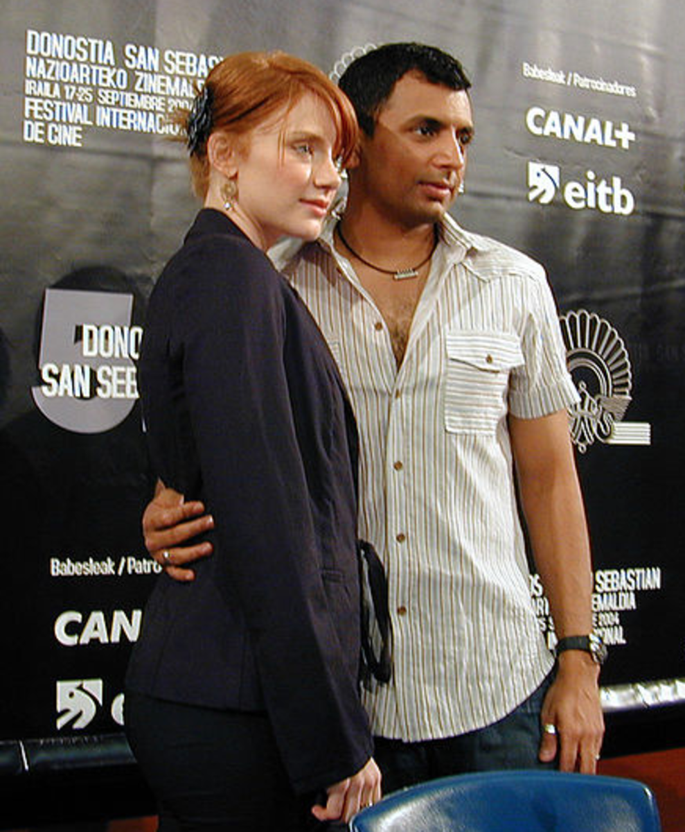 Bryce Dallas Howard and M. Night Shyamalan promoting movie The Village at the San Sebastian Film Festival in Spain.