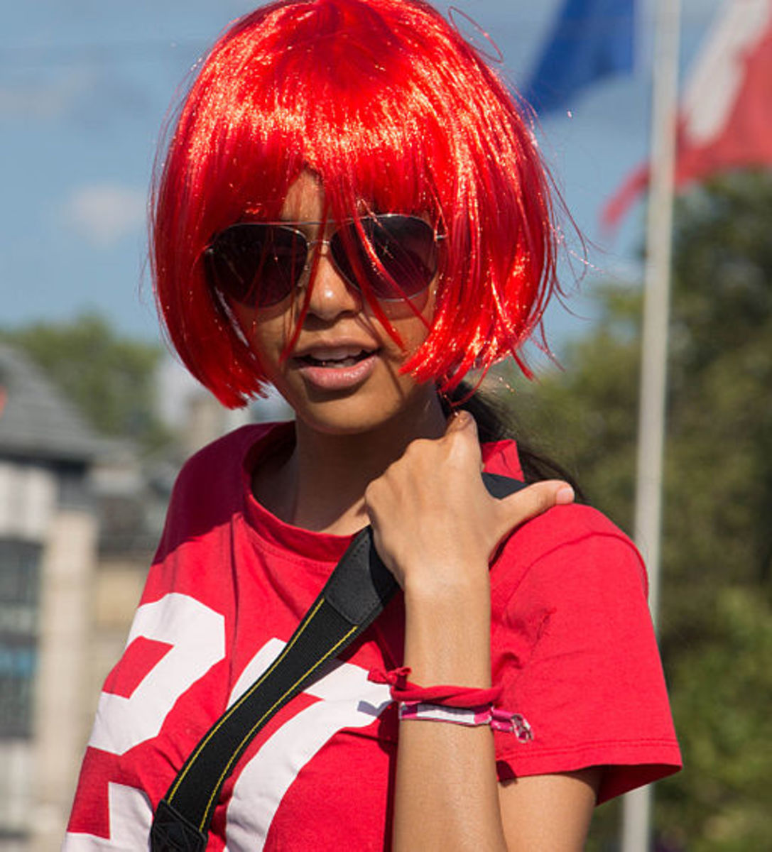 Woman wearing a red wig at Street Parade in Zürich in 2013.