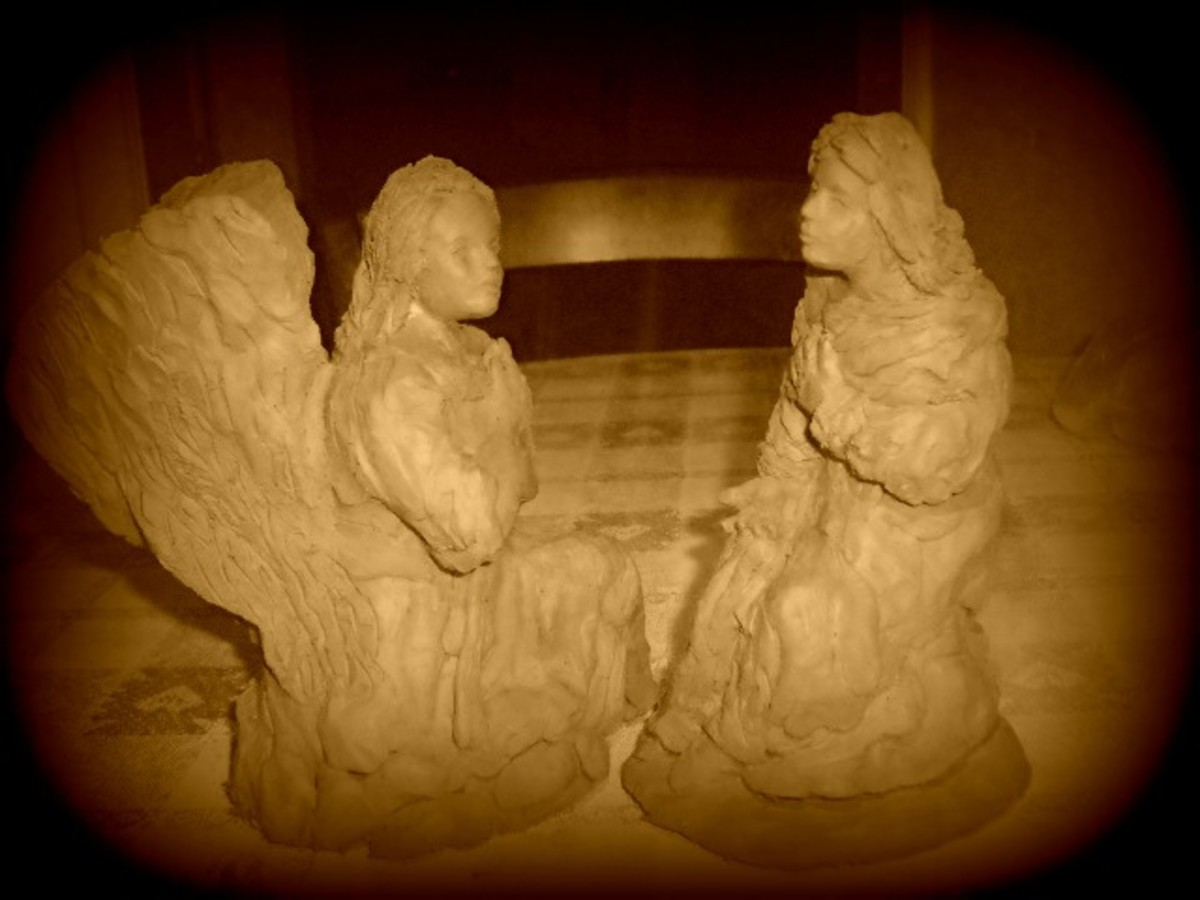 How the finished statue would appear. The lady is sitting down while the angel is kneeling so the Virgin is slightly taller.