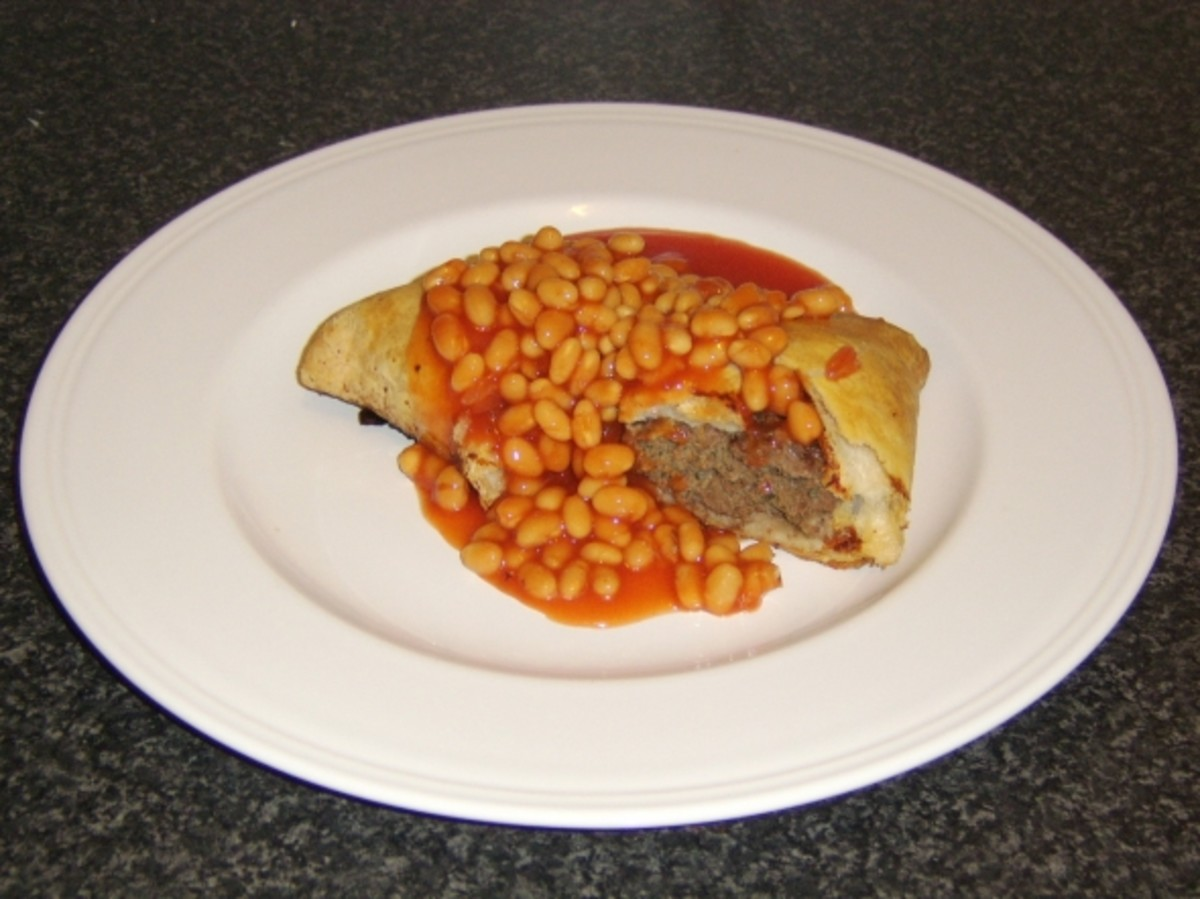 A Forfar Bridie served with baked beans in tomato sauce