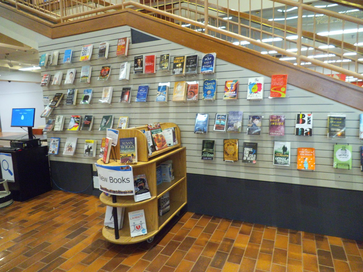 The St John's Public Library in New Brunswick, Canada has a wall for displaying books and a freestanding unit too.