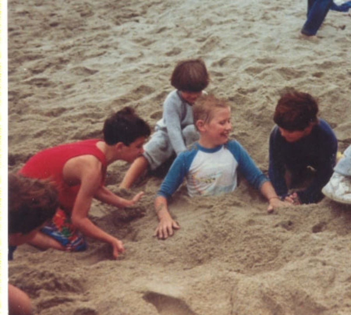Jason's friends burying him in the sand at one of the numerous beach birthday parties at Sycamore Cove State Beach