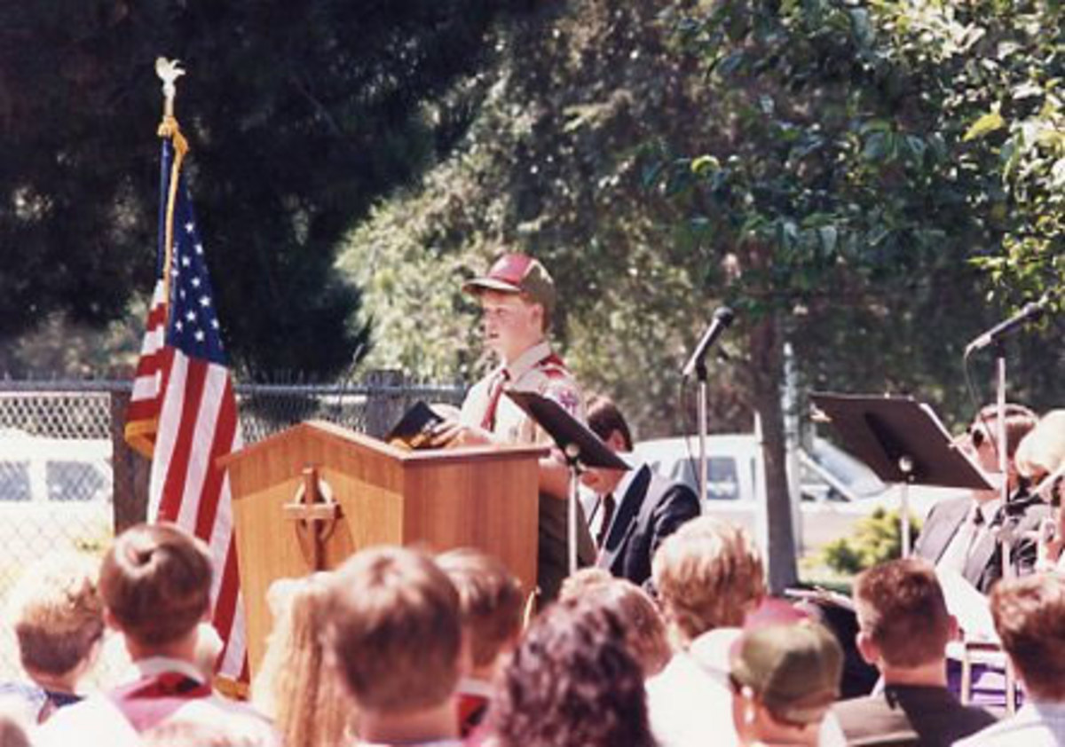 Fellow scout reads a Scripture during the service.