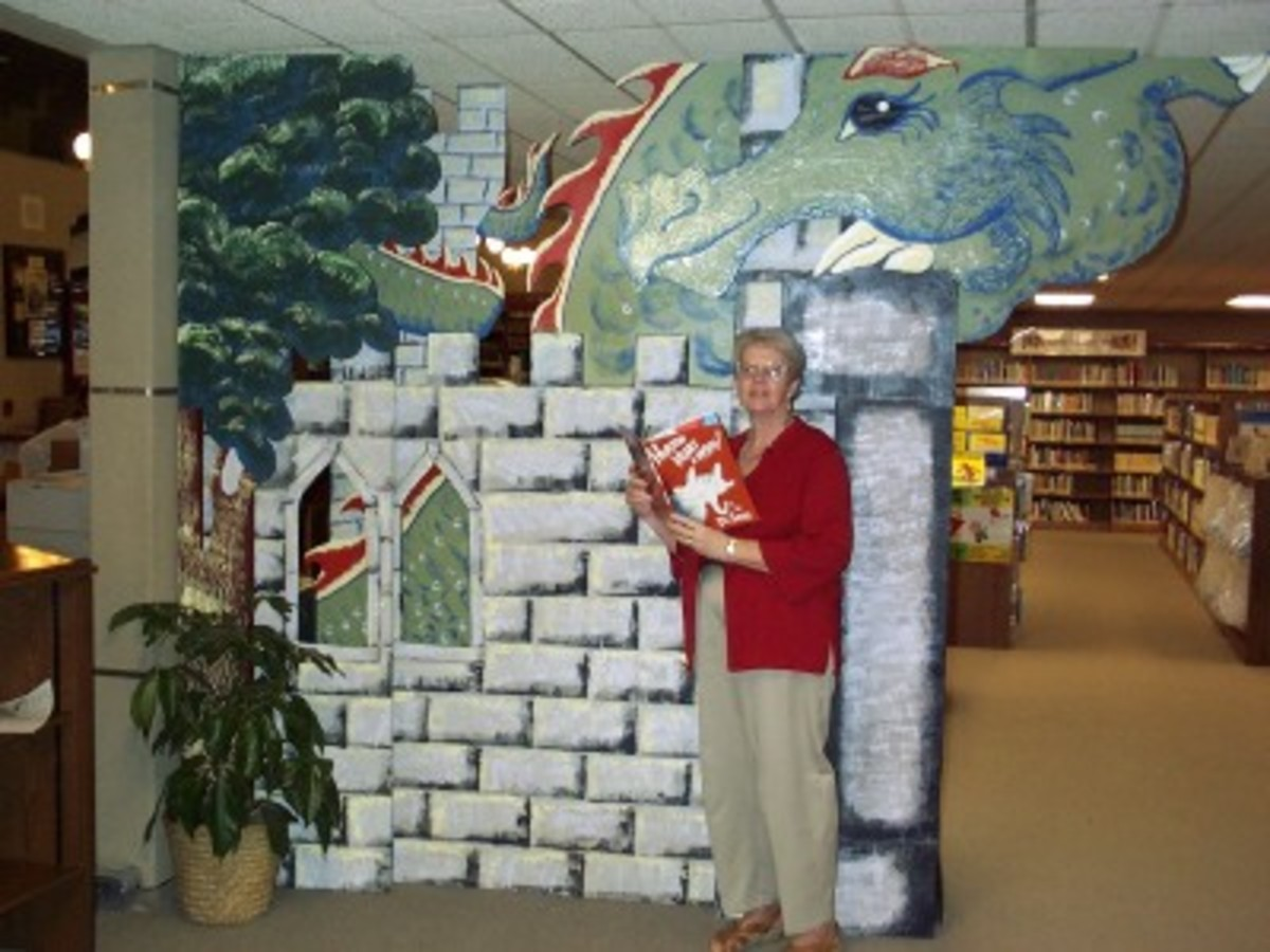 Library Director, Virginia Allain, with the new decorations for the children's section.