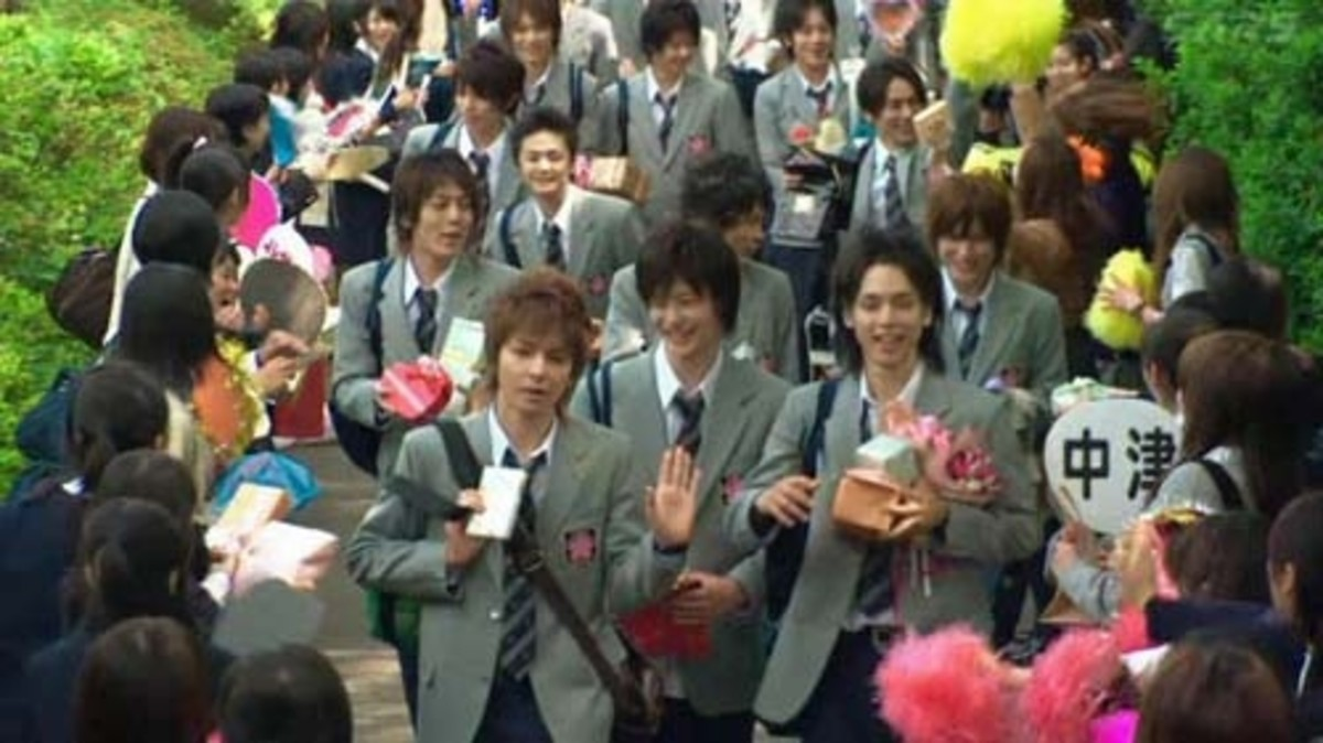 The boys of Osaka Gakuen being mobbed by fans.