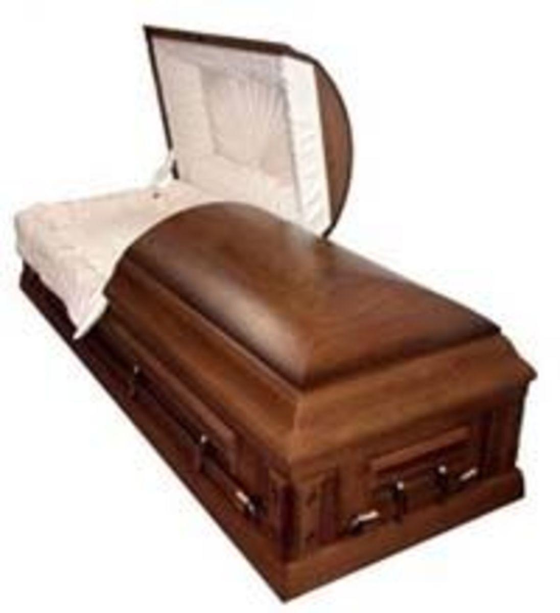 Half-open wood grain casket with white satin lining