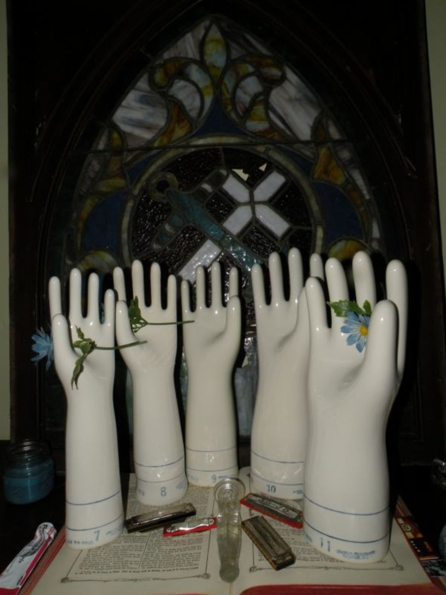"""A variety of glove molds in various sizes. A """"7"""" would be small to medium hand whereas a """"9"""" large to extra large. Jumbo ones were used to make electrical gloves and large rubbers. A variety of sizes of glove molds."""