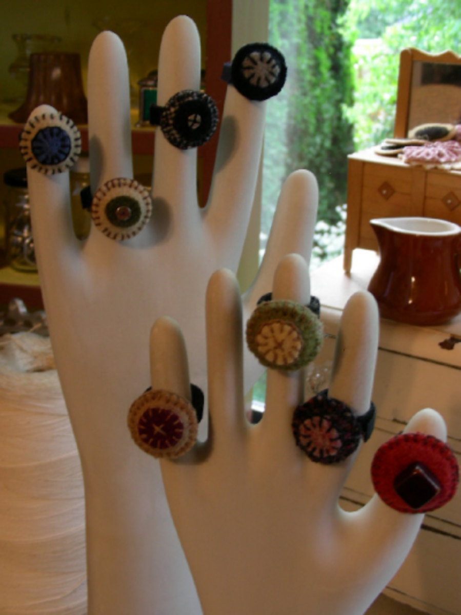 Ragamuffin2006 on Etsy uses her hands to display her gorgeous Penny Rings!