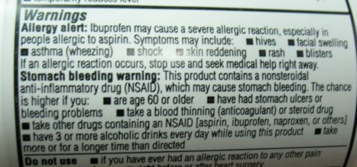 Medication warning on ibuprofen bottle. This warning applies to all NSAID pain medications.