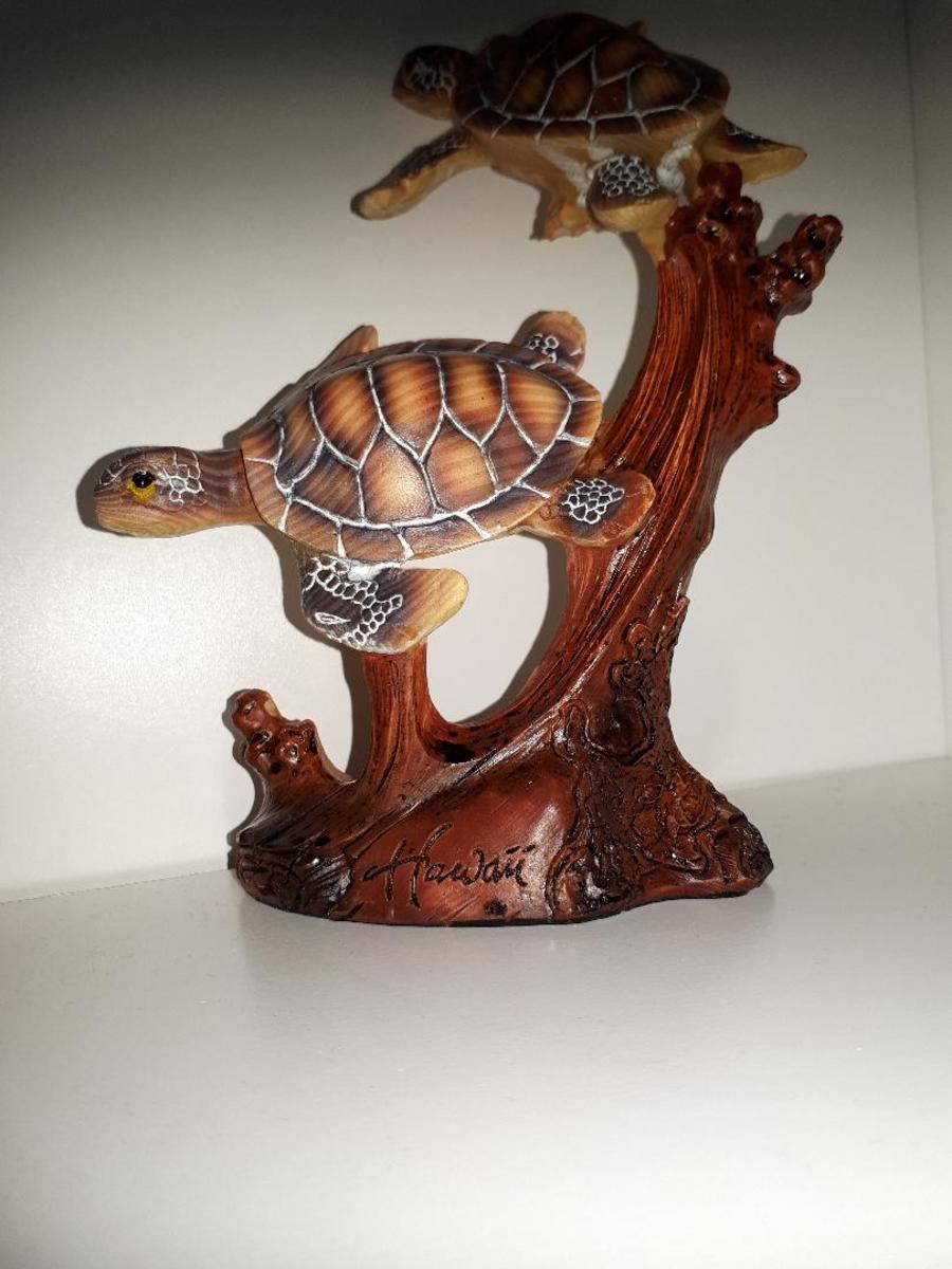 A sea turtle statue makes a cool accessory on a bookshelf or side table.