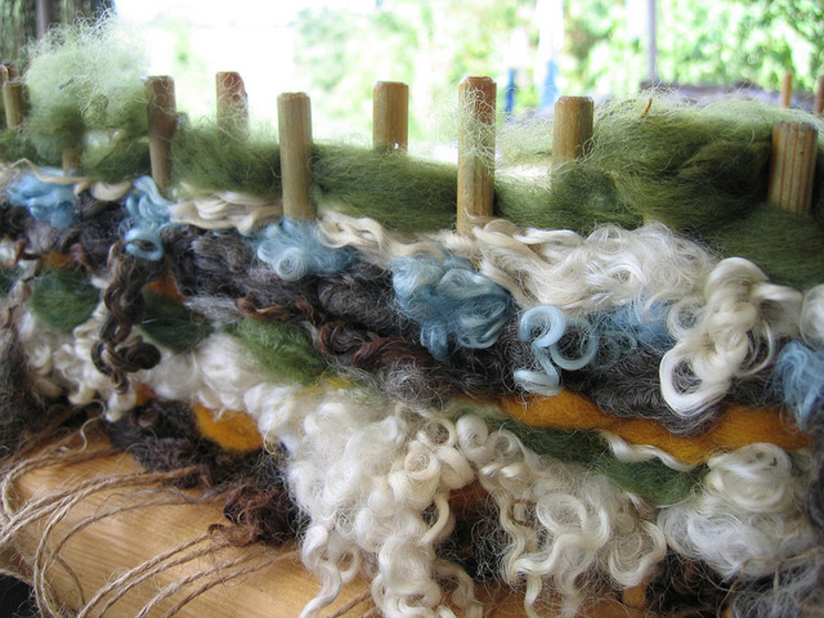 Weaving on a peg-loom with natural plant-dyed wool and wool roving.