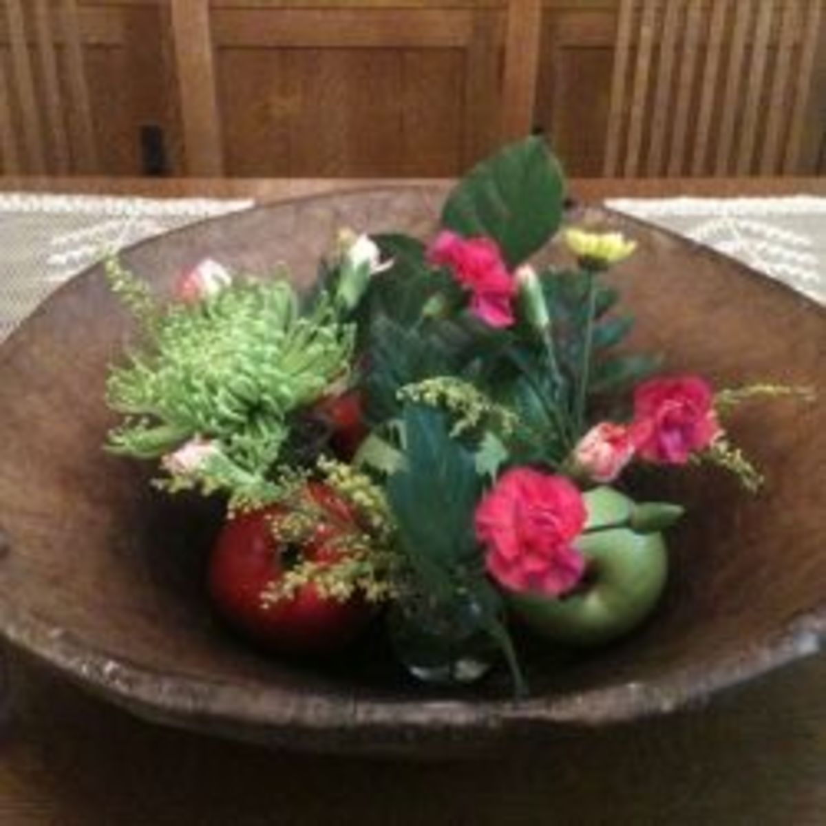 Fresh flowers arranged in a wooden bowl. Photo and floral design by me, Mickie Gee.