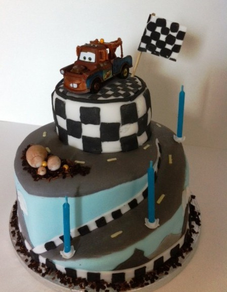 Madar Cake with race car checkers.