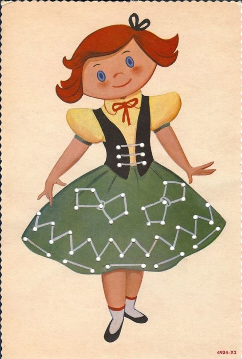 Red-haired girl with green skirt lacing card. Source:  Lulu.com (A clickable link is provided in the introduction paragraph above.)