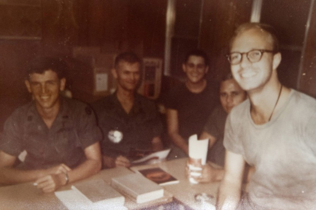 John Wheeler with friends during the Vietnam War. Photo courtesy of the Wheeler Family.