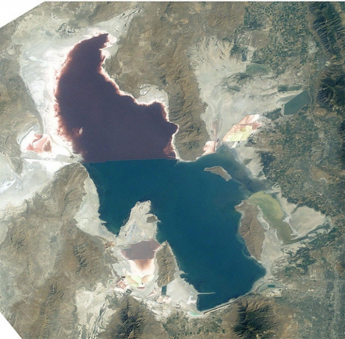 An aerial view showing the diffence in color of the lake on either side of the causeway.   The pinkish color is caused by an algae.