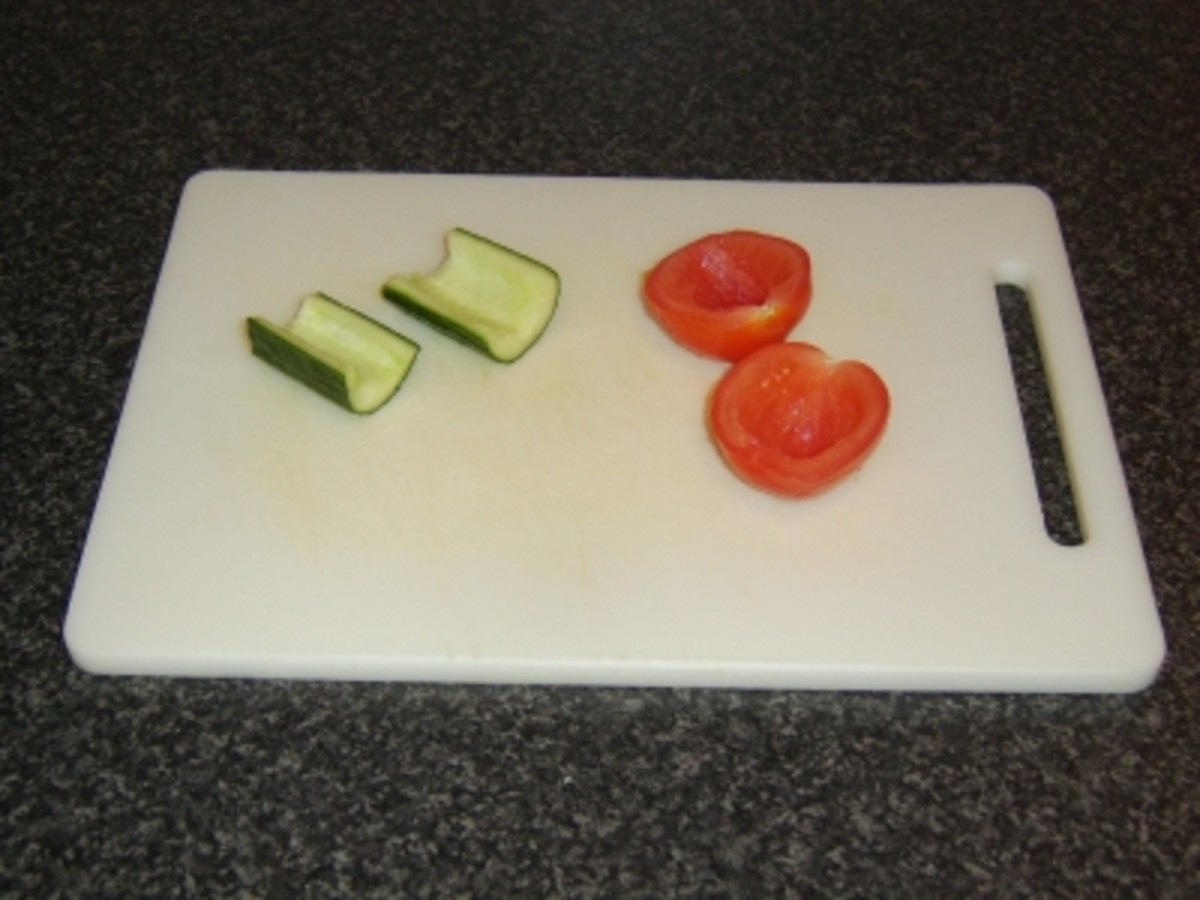 Tomato and cucumber are halved and deseeded