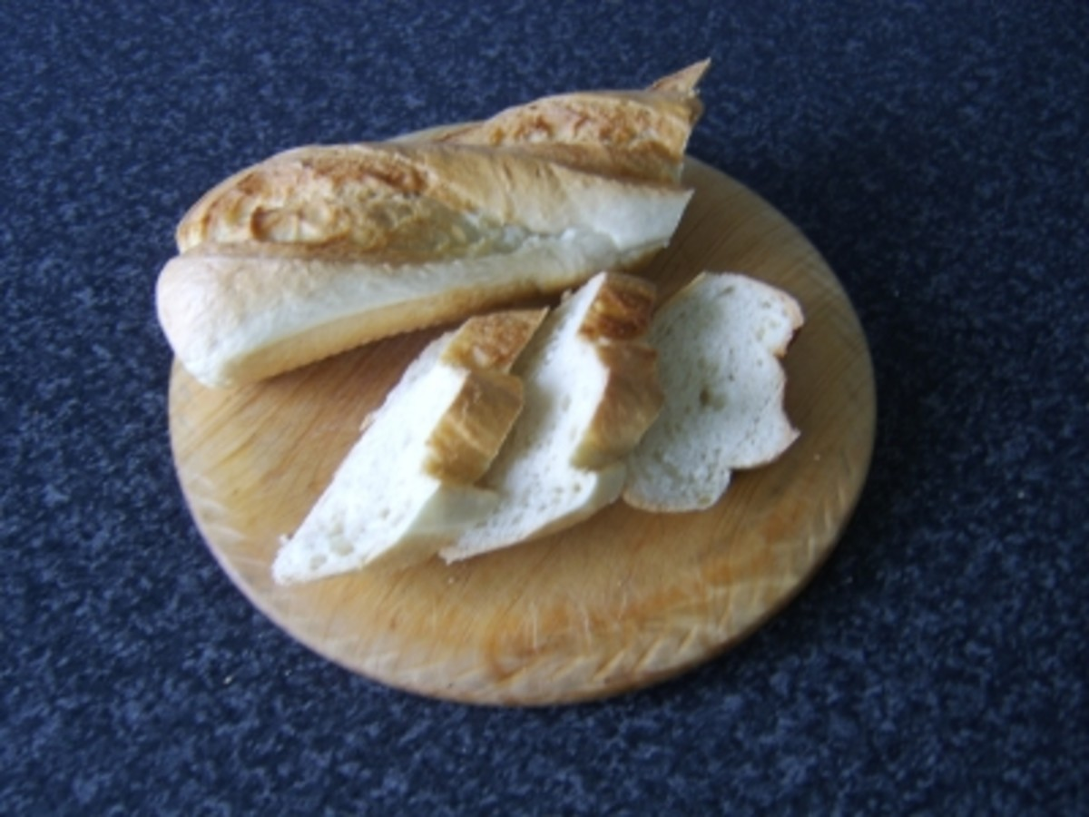 Bread is sliced at an angle to create larger slices