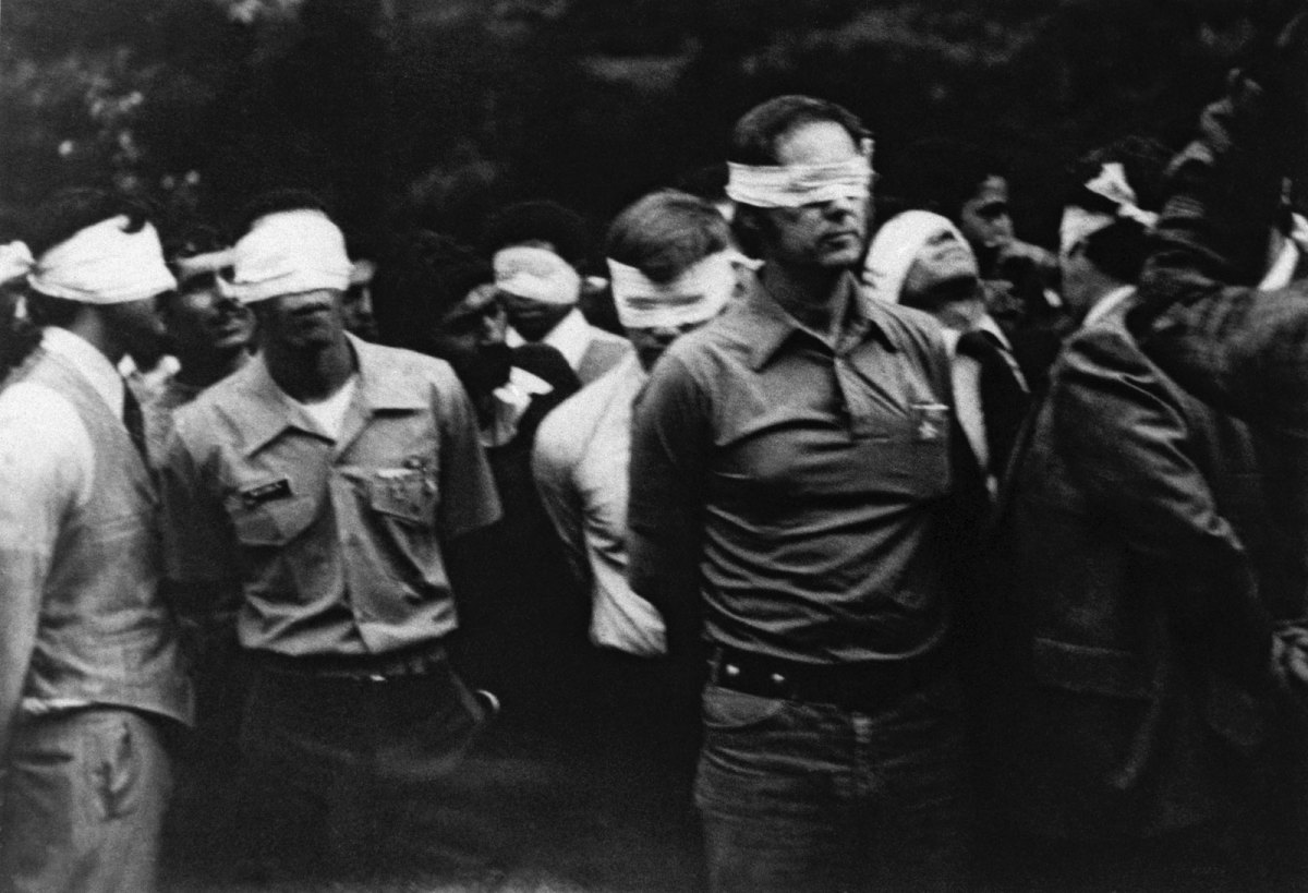 AMERICAN DIPLOMATS TAKEN HOSTAGE FOR 444 DAYS BY ISLAMIC REVOLUTIONARIES IN IRAN, PARADED BEFORE TELEVISION CAMERAS