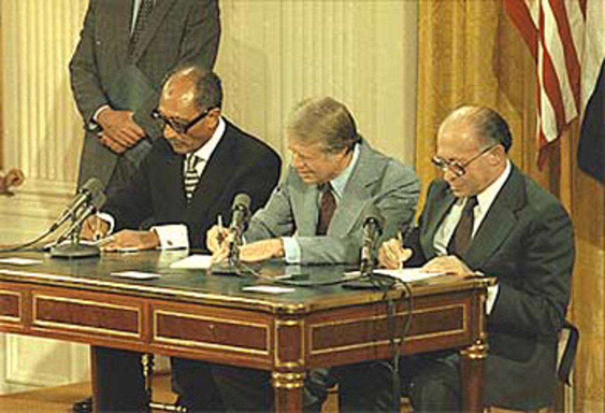 PRESIDENT CARTER SIGNS THE CAMP DAVID ACCORDS WITH ANWAR SADAT OF EGYPT AND MENACHEM BEGIN OF ISRAEL