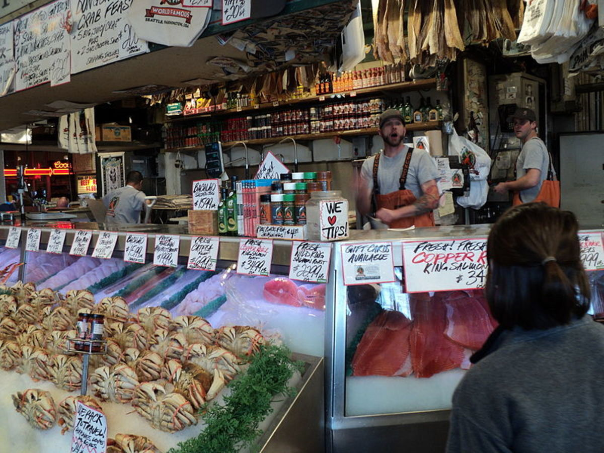 Justin prepares to catch a fish at Pike's Place Fish Market
