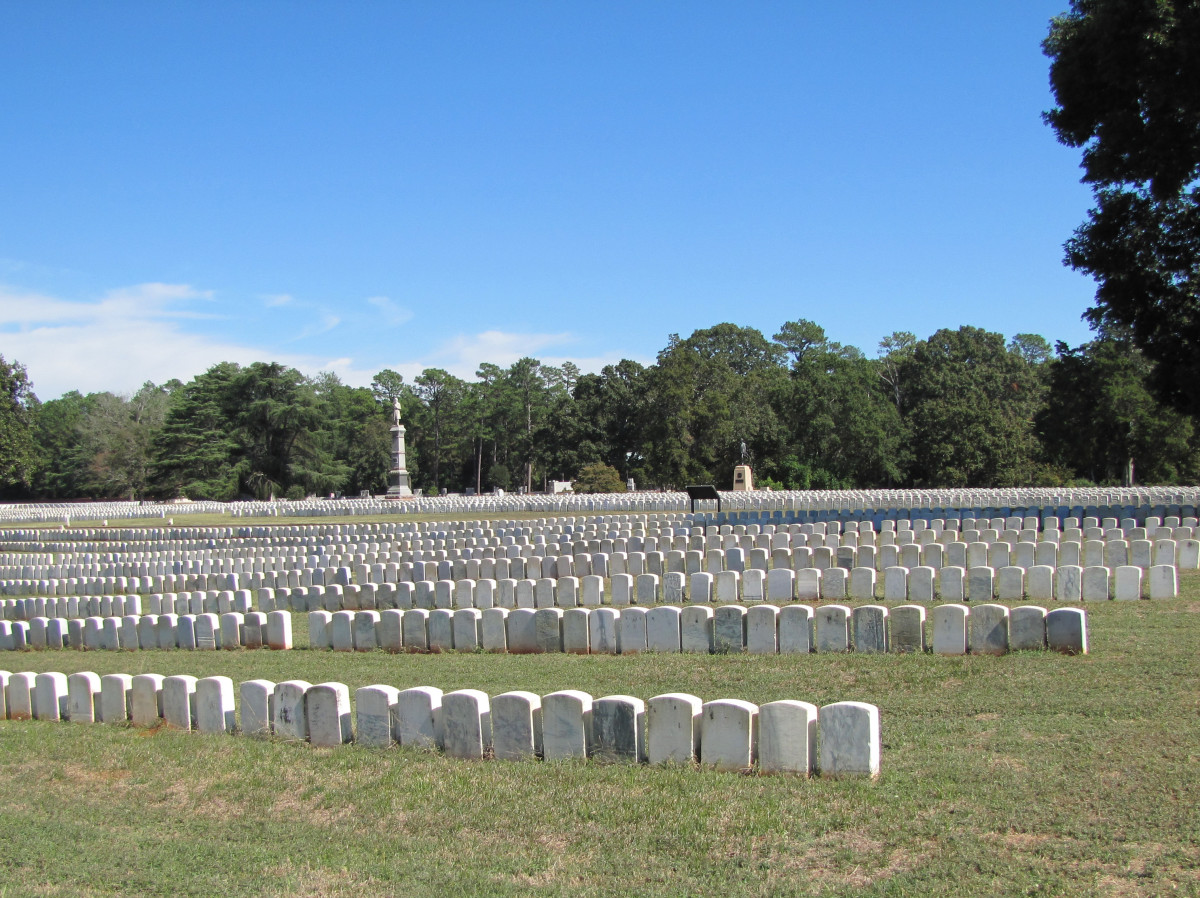 The cemetery shows graves close together as there were mass burials daily.