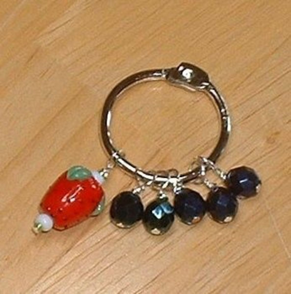 Strawberry and blueberries stitch markers made with  a ceramic strawberry bead and Czech glass faceted beads. All photos here by Peggy Hazelwood.
