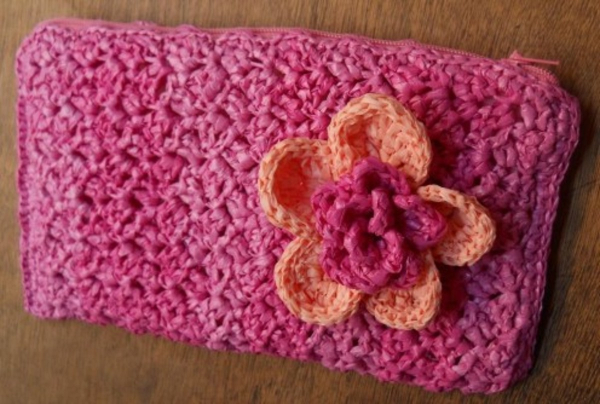 A beautiful pouch which uses the Bushy stitch pattern adorned with Dr. Jeckyll's Flower