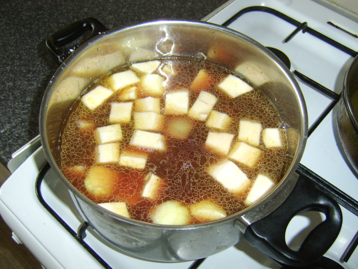The remaining vegetables, stock and wine are added to the cooking pot