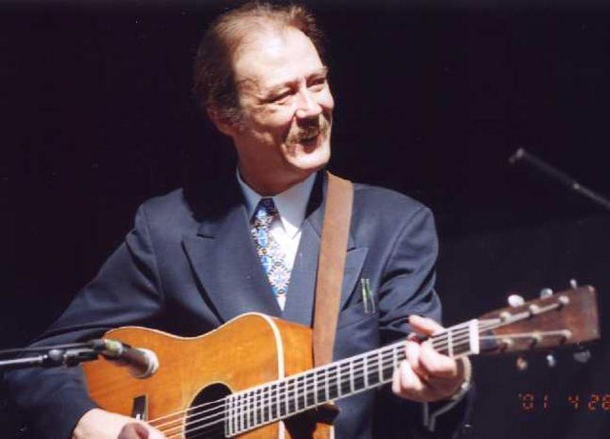 The Santa Cruz Guitar Company.  Tony Rice Professional, and Tony Rice Signature Guitars