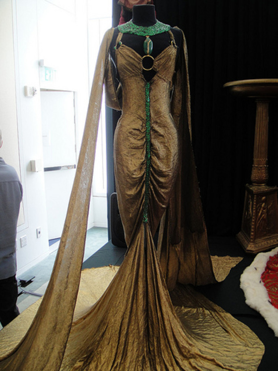 "Debbie Reynolds Auction - Claudette Colbert gold-lame and emerald royal boudoir gown from ""Cleopatra"" (1934) by Kevin Cline, courtesy of PopCultureGeek"