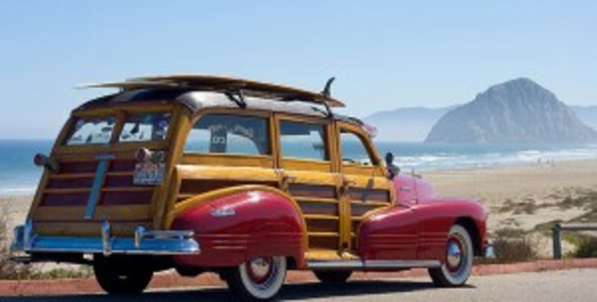 The car now best known as the woody, named in honor of its distinctive wood paneling. Shown here carrying a surf board on its roof - almost as a trophy in celebration of the surfing industry.