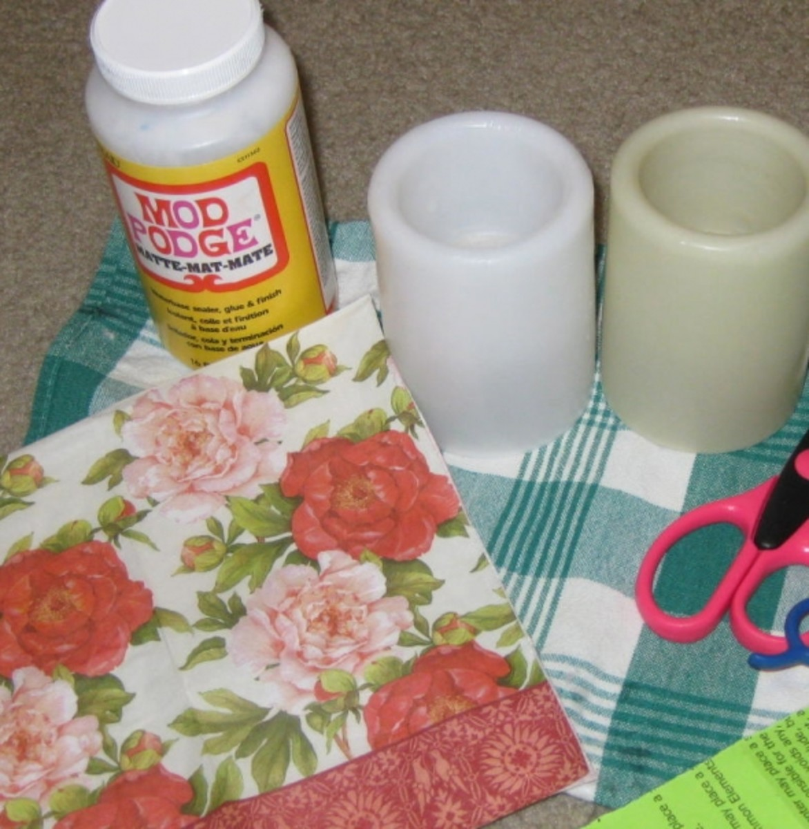 Supplies needed to decoupage flameless candles.