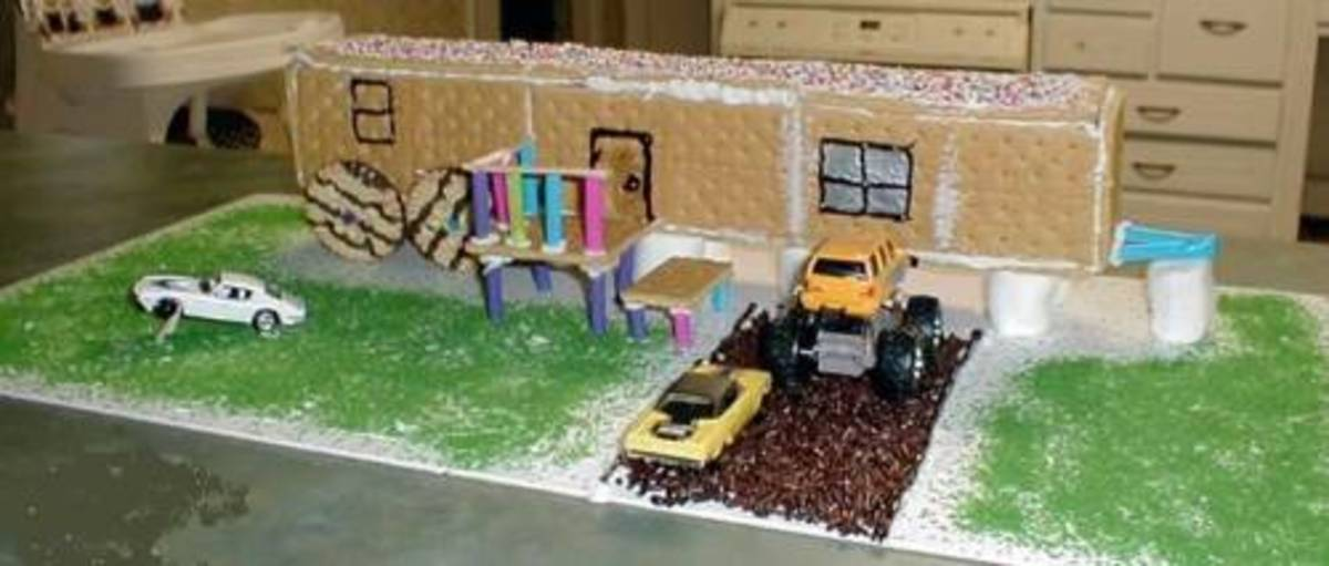 "Ever hear that song ""Lifestyles of the not so rich and famous, holes in all our socks, Ford Fairlane up on blocks?"" Yep, this one reminds me of that song!  The ""Redneck"" gingerbread house!"