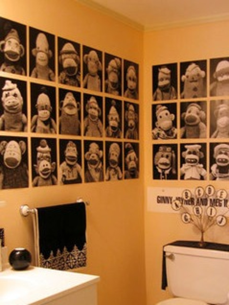 Make cheap half bath decorations by framing your arty photos, greeting cards or calendar art.