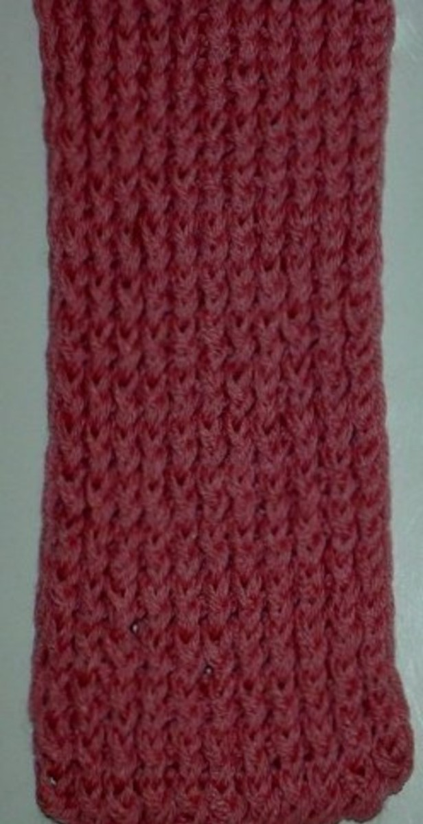 Figure eight wrap scarf done with 2 strands of yarn as one in pink.