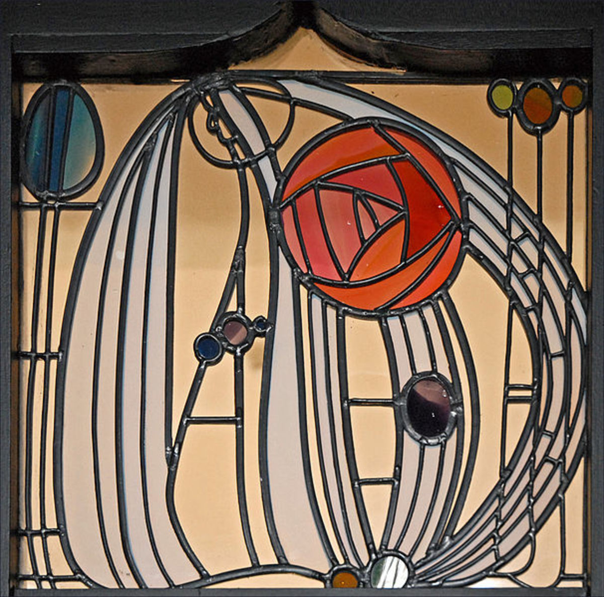 The MacKintosh rose set in stained glass, within a window panel designed for the House for an Art Lover in Glasgow, designed in 1901 and posthumously built in the late 1980s