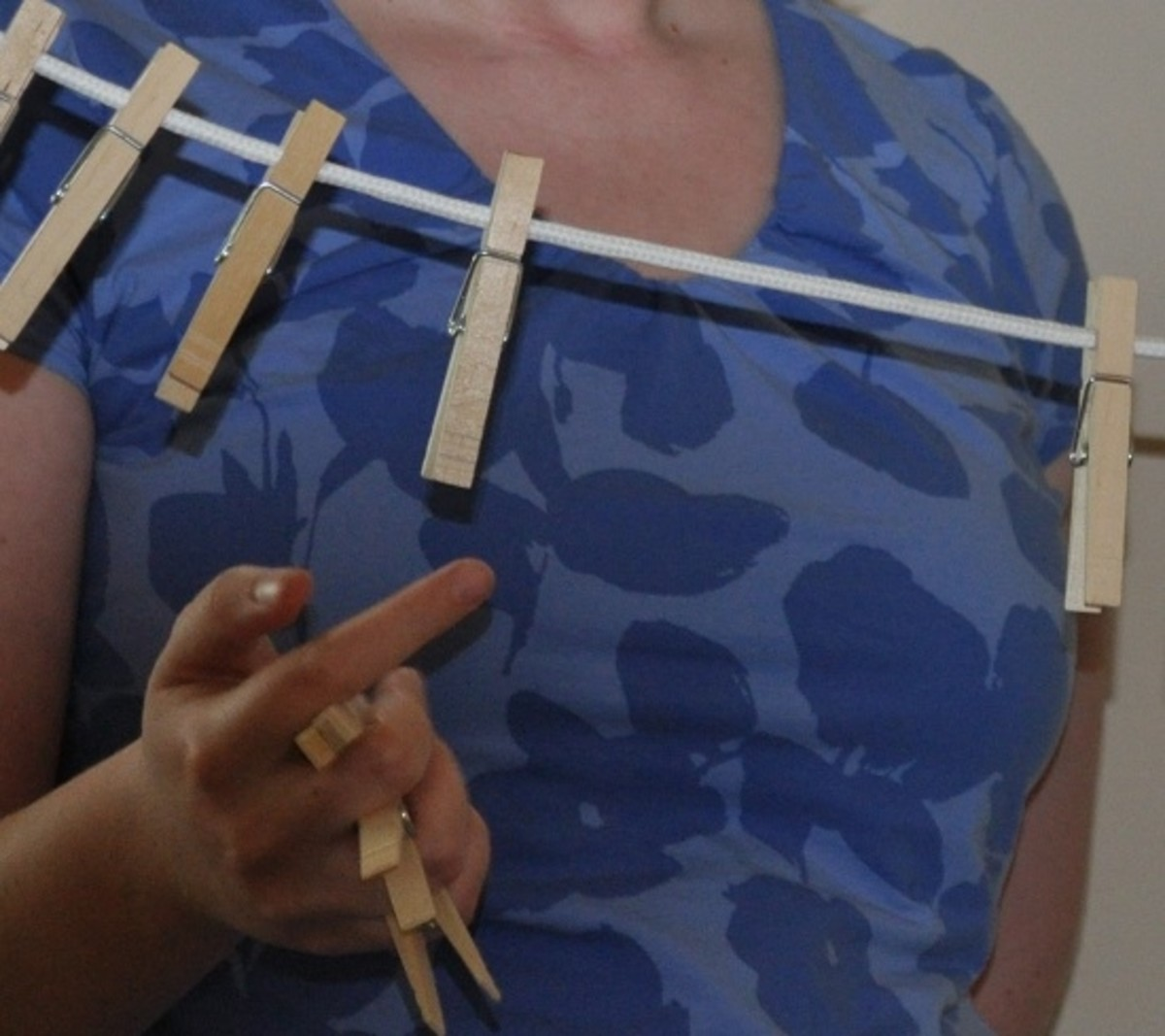 Dexterity rules in the Clothes Pin Shower Game