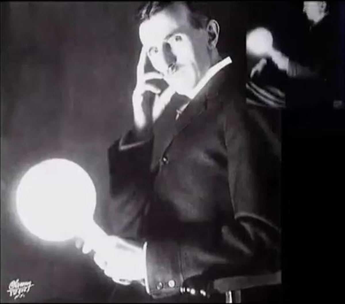 Nikolai Tesla transmitting AC current through his body illuminating a light bulb.