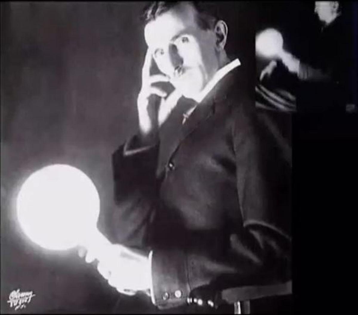 Nikolai Tesla transmitting AC current through his body illuminating a light bulb.