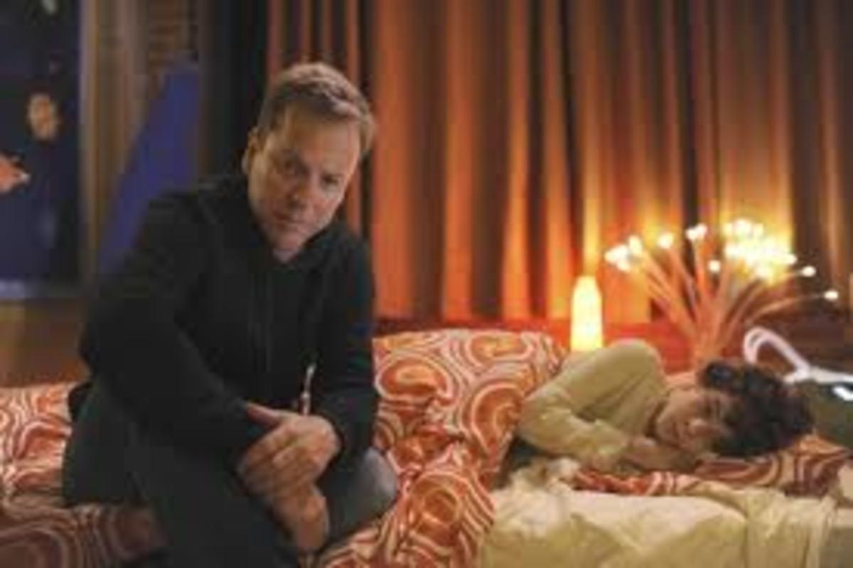 Martin tucks Jake into bed