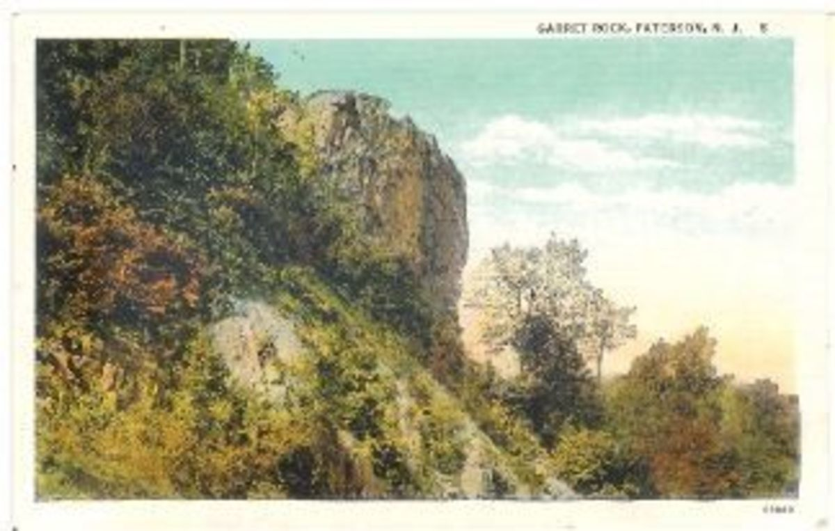 Garret Rock, Paterson, N.J. The back reads: Garret Rock is a familiar landmark in the Garrett Mountain Reservation of The Passaic County Park System. The Reservation consists of 600 acres maintained by The Passaic County Park Commison.The postcard wa
